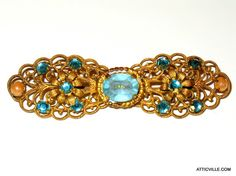 Antique Filigree Bar pin Brooch with Blue rhinestones and pearls from Germany.  From The Attic Vintage Clothing.