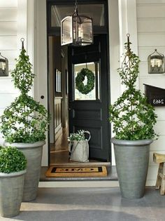 Planters, selected by the wife and filled with hydrangeas, flank the front door.Planters, selected by the wife and filled with hydrangeas, flank the front door. Front Door Planters, Front Door Porch, Front Door Entrance, Fall Planters, Front Entrances, Front Door Decor, House Front, Mailbox Planter, Recycled Planters