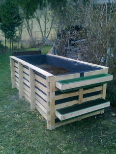 """My almost finished """"Hochbeet"""" (raised bed)...made with recycled, FREE Europallets.  (Total cost: 22 EUR. Plastic liner, wire bottom to protect against chewing critters)."""