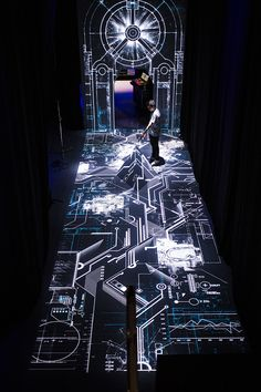 real-time audio and video effects are projected on the walls image courtesy of wonderland group moment-factory-creates-a-multimedia-experience-for-oakley-designboom-08