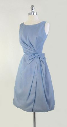 really pretty blue, darting in bodice works, ad like the idea of the wrap dress with the draping -- vintage 50's 60's light blue bow party wedding dress gorgeous!!!