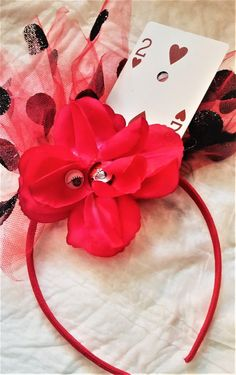 Mad Hatter Inspired Headband: Red Playing Card is a wild and whacky statement for TWEENS;     I'm a Shopify merchant with Buyable Pins and I want a conversion tag. I'm not an advertiser.
