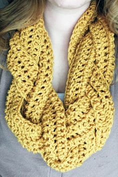"Braided Scarf- 60 or so chain stitches (depends on your desired length) Double crochet back onto the chain Repeat for a total of five rows of double crochets(not including chain) x3 Take your three ""mini scarves"" and braid them together.Then sew your ends to make it an infinity and you're all set!"