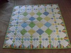 Memory quilt idea Love the striped triangle in the borders. Cot Quilt, Lap Quilts, Strip Quilts, Patch Quilt, Small Quilts, Borders For Quilts, Charm Square Quilt, Charm Quilt, Baby Girl Quilts