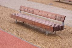 Beautiful wood bench that would also require a lot of maintenance and wouldn't tolerate graffiti very well. Good for a protected, more private area.