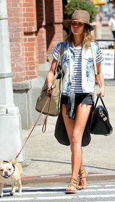 Add an element of cool to your ensemble with a denim vest and studded sandals // #ChrissyTeigen #CelebrityStyle