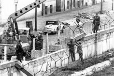The Beginnings Of The Berlin Wall On August 1961 the German Democratic Republic began building the Berlin Wall using only basic materials. It was a concrete barrier that was guarded as well in order to divide Berlin. West Berlin, Berlin Wall, Playground Slide, Bataan, Terrain Vehicle, Wd 40, Bonnie N Clyde, Moon Landing, National Archives