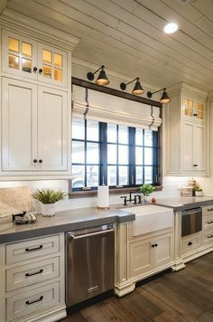 Off white kitchen with grey quartz countertop. The surrounding countertops are Grey Expo Quartz. #Offwhitekitchen #greyquartz #greyquartzcountertop off-white-kitchen-with-grey-quartz-countertop Alicia Zupan