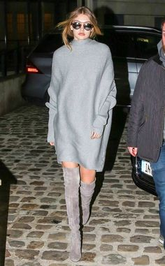 Shades of Grey from Gigi Hadid's Street Style  Gigi dresses in monotone grey, effortlessly throwing on a sweater dress and Stuart Weitzman knee-high boots.