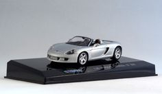 711 Collection 671006 Porsche Carrera GT 2001 in silver. 1:43 scale. Mounted on named plinth under a clear plastic cover but is easily removed. 1:43 scale. Diecast with plastic parts.  Visit http://thegeniescave.co.uk/product-category/diecast/711-collection/