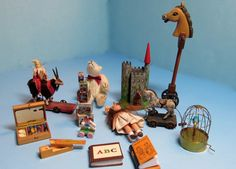 Patricia Paul Studio: Miniature Spring Cleaning.- goat pull toy by Barbara Logan, horse pull toy by Linda Masters, ABC book by Barbara Brear, Pencil box by Alan Waters & paint box by St. Leger