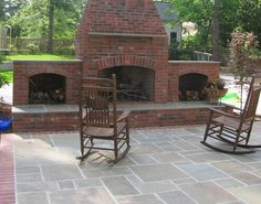 Another brick patio fireplace