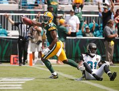 Green Bay Packers wide receiver Davante Adams (17) celebrates after catching a pass for a 29-yard touchdown in front of Jacksonville Jaguars cornerback Davon House (31) during the first half of an NFL football game in Jacksonville, Fla., Sunday, Sept. 11, 2016.