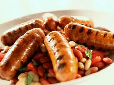 Grilled Sausage with Tuscan Beans Recipe : Sandra Lee : Food Network - Sandra's alfresco hot Italian sausage is served with cannellini and red beans. Food Network Recipes, Food Processor Recipes, Cooking Recipes, Healthy Recipes, Hamburgers, Grilled Sausage, Pork Ham, Grilled Zucchini, Hamburger