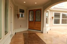 Outdoor entry of a custom home by G.J. Gardner Homes