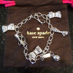 Kate Spade Bow Charm Bracelet. Silver. Six charms. Two different types of bows. Slight scratches on back of bows but hardly noticeable. Comes with dust bag. kate spade Jewelry Bracelets
