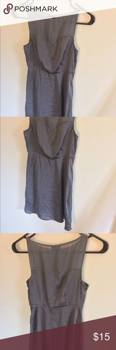 Never worn dress with illusion neckline Very pretty gray dress with an illusion neckline and back. The zipper is on the side and the skirt is flowey Dresses Mini