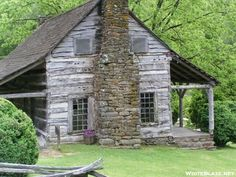Antique Log Cabin with stone fireplace....wonderful !!