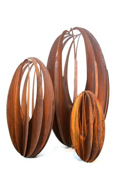 Lump Eggular sculptures made from Corten steel with a natural rusted finish