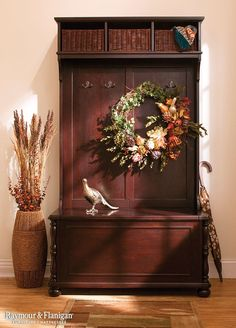 Your hall tree isn't just for organization, it's also to show off your style. When you're expecting guests, hide the jackets away in the bottom storage bench and class it up with a beautiful wreath.