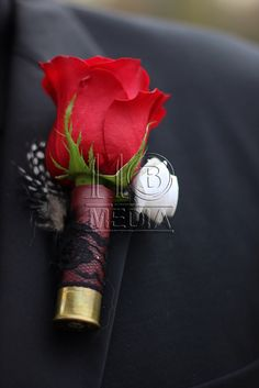 Better if it wasn't a red rose. Shotgun shell boutonnière black and red