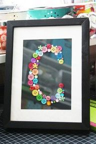 Print a letter on your printer, and glue on various size buttons. Voila! Instant art. Summer's & TK's room....