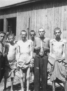 A group of survivors pose in front of a barracks in the newly liberated Ebensee concentration camp. Ebensee was a subcamp of Mauthausen.