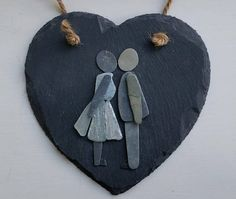 A unique little gift for a special person on Valentines Day or an anniversary or birthday gift. A kissing couple created from sea glass and stone set on a 15cm x 15cm slate heart strung with jute all ready to hang on your wall. Sea glass is created from waste glass being thrown