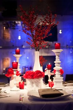 i love the pops of deep red against the white! A romantic color scheme for an evening wedding during the fall or winter