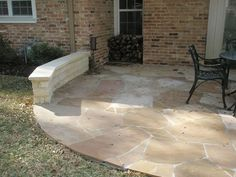 Flagstone Patio With Cement Base And Stone Bench.