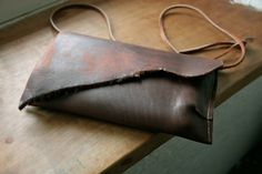 Small Leather Bag - brown genuine leather envelope Clutch - raw cut mini purse for keys and wallet Upcycled leather. €95.00, via Etsy.