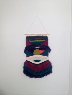 This colorful open warp tapestry was hand woven with love vibes in Long Beach, CA.    Made of cotton, acrylic & wool threads.  Since it was made