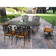 Hampton 7 Piece Dining Set by Oakland Living. $2580.99. Fade, Chip and Crack Resistant. Hardened Powder Coat Finish in Antique Bronze for Years of Beauty. Easy to Follow Assembly Instructions and Product Care Information. Galvanized Assembly Hardware. Rust Free Aluminum Construction. 7214-7201-7202-13-D54-AB Features: -Fade, chip and crack resistant. Includes: -Set includes one dining table, four fully welded dining chairs with sunbrella cushions and two swivel ro...