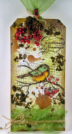Christmas card using distressing techniques, embossing, glitter and mica flakes. Nice touch with the twine and netting.  Suzz's Stamping Spot