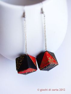 Origami earrings. Site is in Italian, but can probably be translated with Google easily enough.