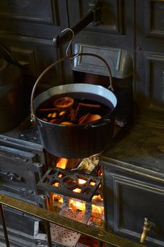Wood burning stove and what appears to be mulled wine or spiced tea. Perfect for a winter warm up.
