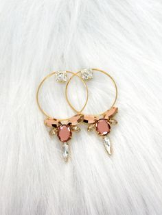 Bridal Hoop Earrings, Blush Pink Statement Earrings, Big Hoop Bridal Earrings, Bridal Large Gold Hoop Earrings, Swarovski Blush Big Earrings Timeless Gold Hoop Feather Light Swarovski Statement Earrings ♥ Petite delights original design Petite Delights is an Official SWAROVSKI® Branding Partner Made with real genuine high quality Austrian Swarovski ©Crystal and settings . Our brand is legally licensed & authorized By Swarovski Company for high quality manufacturing. This pair comes with...