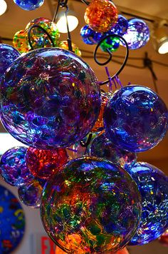 Sphere, circular, bubbles, spectrum, hanging, rod iron, transparent. Love.  http://www.artsquest.org/venues/glass.php