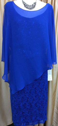 Stretch shimmering lace dress Chiffon overlay Very forgiving style Diamante detailing on the shoulders Sleeves include slight slit Sizes: 14 - 24 Our price: $25