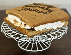 Giant S'mores Cake. Fudge brownies and toasted marshmallow cream sandwiched between two huge graham crackers.
