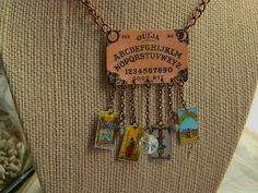 Ouija board tarot cards pendant mixed media jewelry Steampunk Halloween costume Sarah Wood. $27.00, via Etsy.