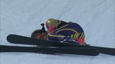 Marcus Brigstocke falls during ski cross