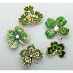 FIVE ENAMELED GOLD CLOVER BROOCHES, 1910-1940. 14k yg. hand painted and…