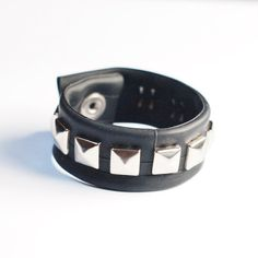 Check out this item in my Etsy shop https://www.etsy.com/uk/listing/266401583/pyramid-studded-inner-tube-wrist-cuff
