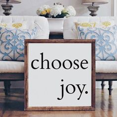 """""""Choose Joy"""" Size is Approximately: 26"""" x 26"""" White Printed Board + Black Text + Stained Wood Frame Please note these boards are lightweight (2-6 pounds) making decorating and rearranging a breeze! Ha"""