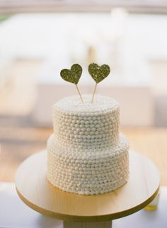 Wedding Cake | Hearts Cake Topper | on SMP: http://www.stylemepretty.com/2013/11/20/seaside-florida-wedding-from-lauren-kinsey | Photography: Lauren Kinsey Fine Art Wedding Photography