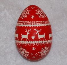Christmas Pysanky Goose Egg Ornament, Red and White Reindeer, Snowflakes and Hearts Sweater Pattern. $22.00, via Etsy.