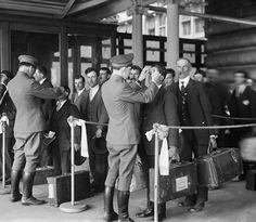 Immigrants at Ellis Island undergoing a health inspection, 1920. Many immigrants flocked to the United States during the 20's to escape poverty, war, or an over-ruling government.