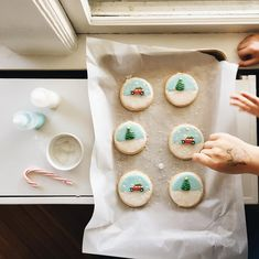 HOW TO: for everyone asking, squeeze bottles are key. You make the icing using powdered sugar and water, but you want one bottle of icing to be thicker than the others. This will be the...