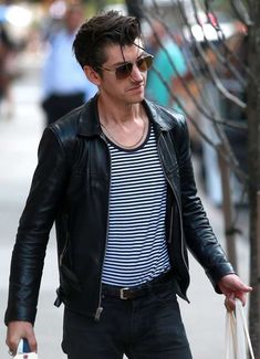 Alex Turner Photos - Arctic Monkeys singer Alex Turner and his girlfriend Taylor Bagley check out of their hotel on August 2015 in New York City, New York. - Alex Turner and Taylor Bagley Step out in New York Arctic Monkeys, Alex Turner Leather Jacket, Taylor Bagley, The Last Shadow Puppets, Saint Laurent Paris, Paris Saint, Hommes Sexy, Cool Shirts, Indie Scene Outfits